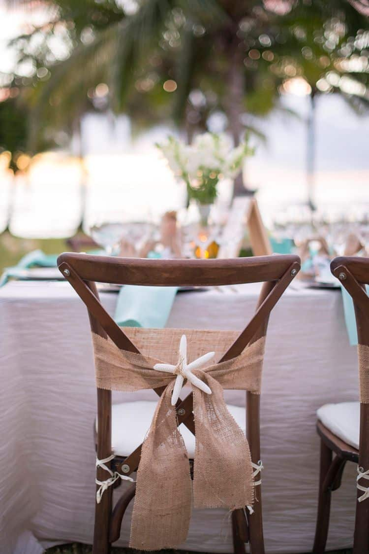 Unique beach wedding chair with burlap sash and starfish detail