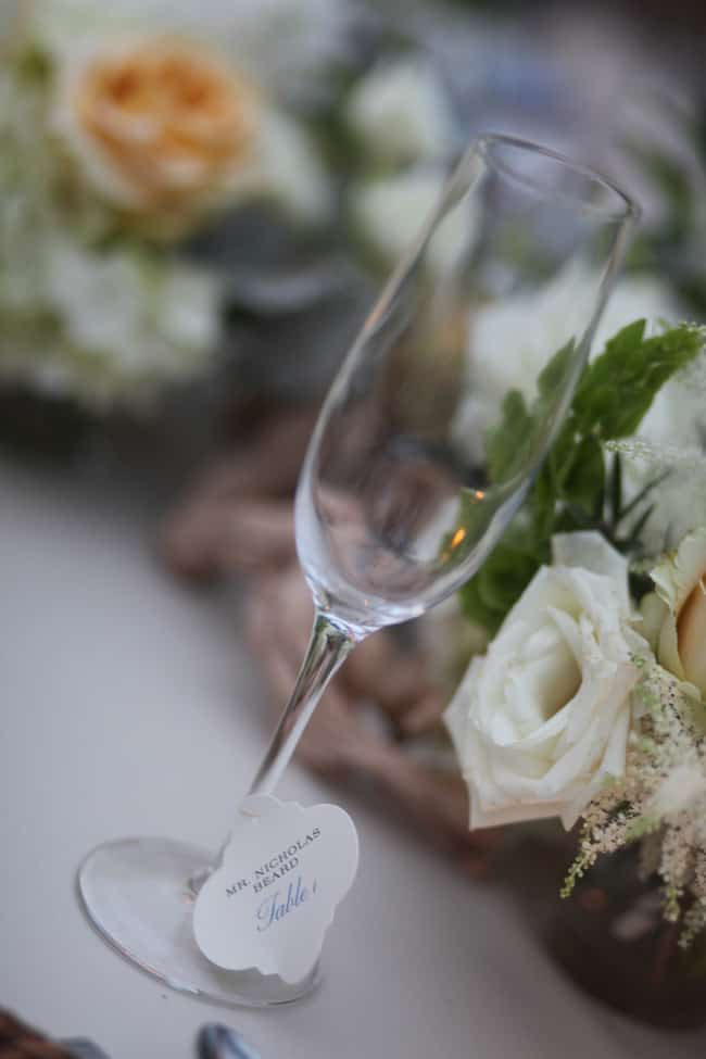 wedding seating cards on champagne glasses