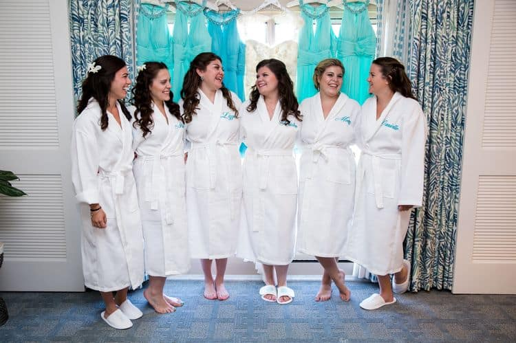 white bridesmaid robes with aqua personalization
