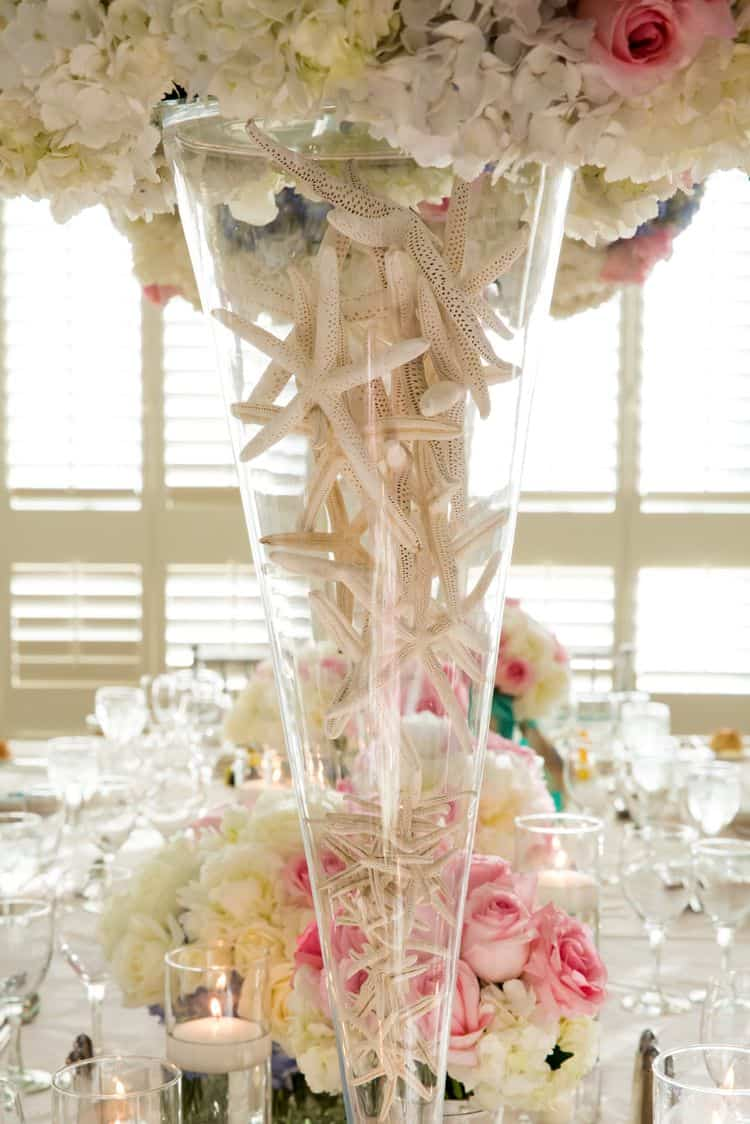 Stunning centerpieces with starfish detail in the vase