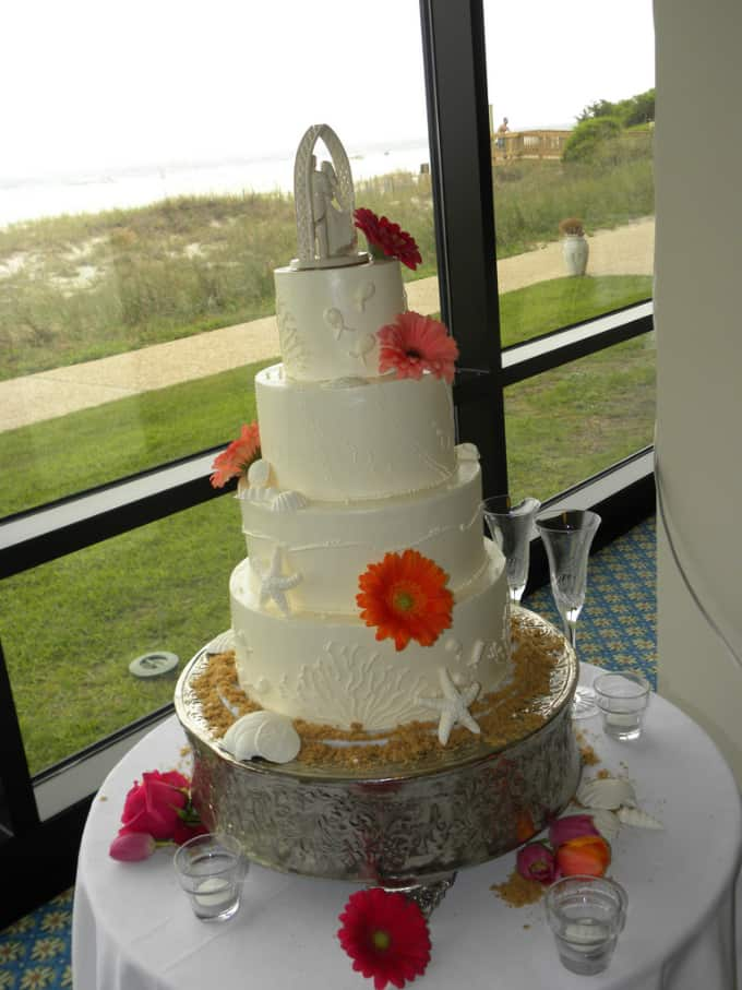 beach theme wedding cake with flowers and starfish