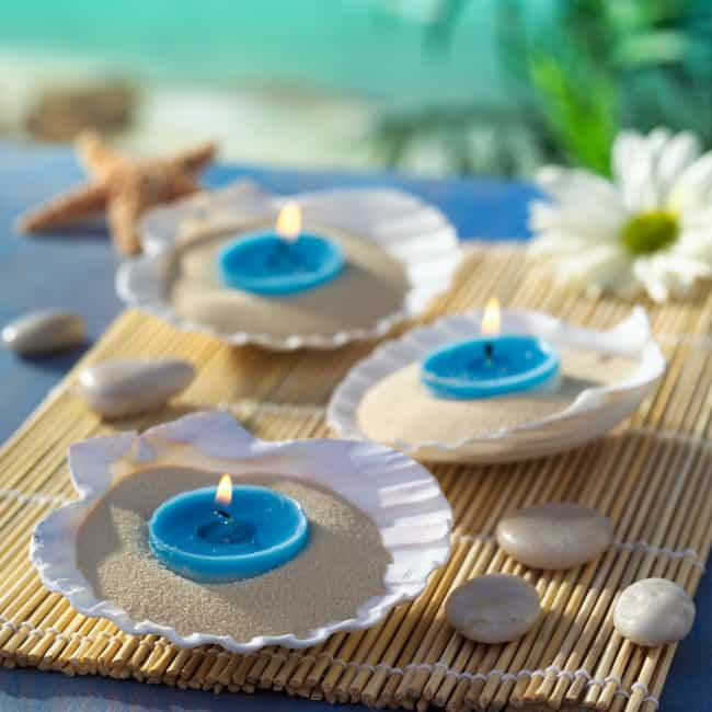 beach theme wedding centerpieces with blue candles