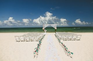 A Beautiful Beach Wedding Aisle Lined with 500 DIY Paper Hearts