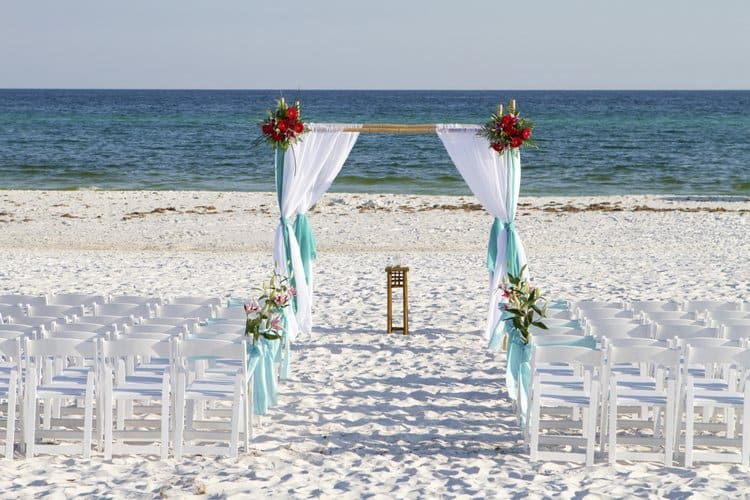 Beach wedding arch deoration in blue and white