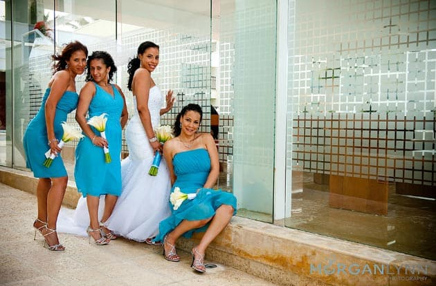 Destination wedding bridesmaids in turquoise dresses