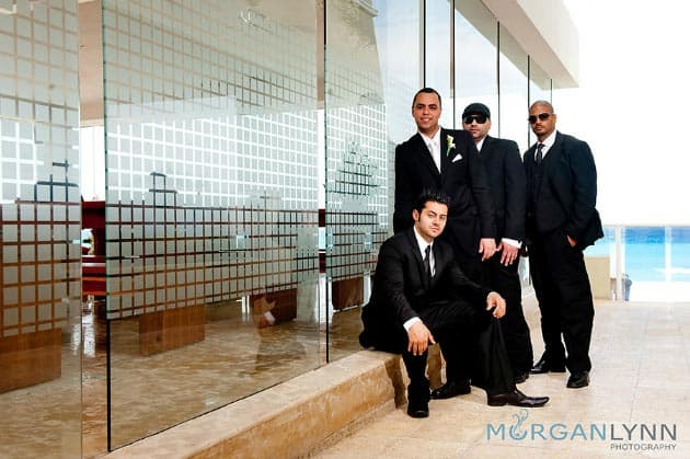 destination wedding groomsmen in black suits