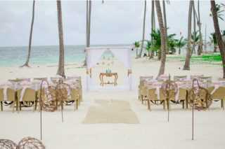 Should you still send an invitation to guests who told you they can't go to your destination wedding?