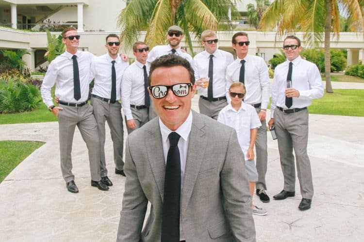 The groom wearing fun sunglasses