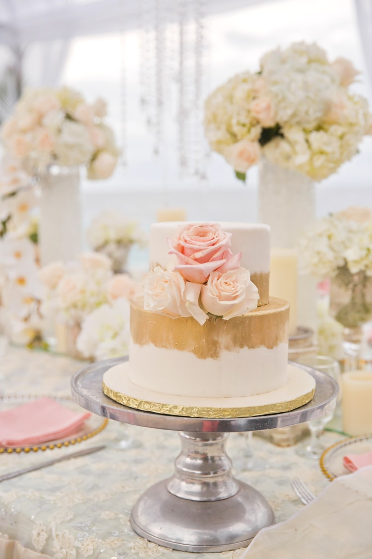 two tier gold and blush destination wedding cake