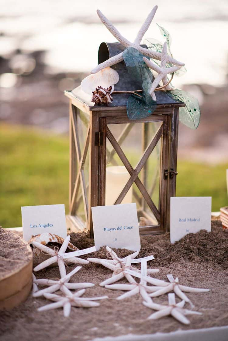beach wedding lantern and starfish seating cards