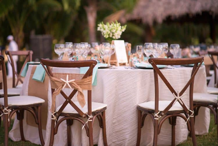 beach themed wedding chairs with burlap sash and starfish detail