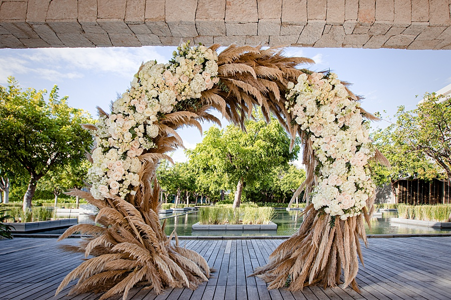 Dramatic Grass and Flower Wedding Ceremony Arch
