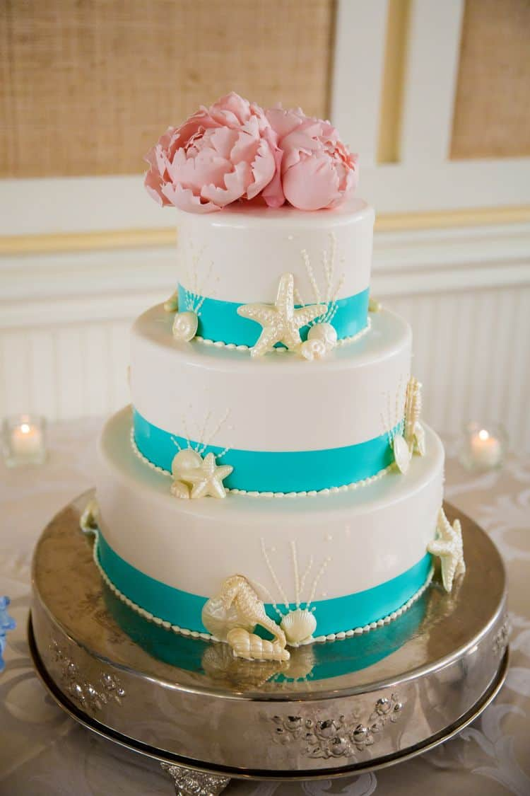 Gorgeous beach wedding cake in white and aqua with pink flowers