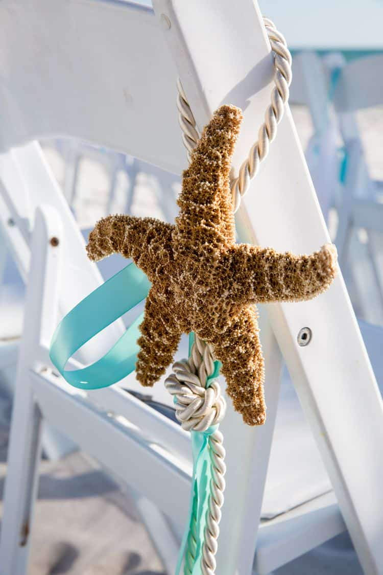 Starfish beach wedding ceremony chair decorations