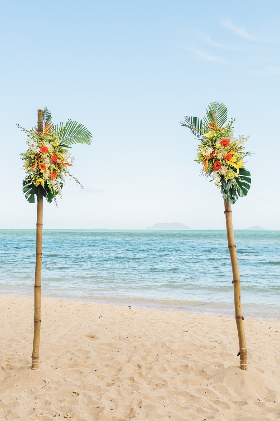 beach wedding arch decorated with flowers