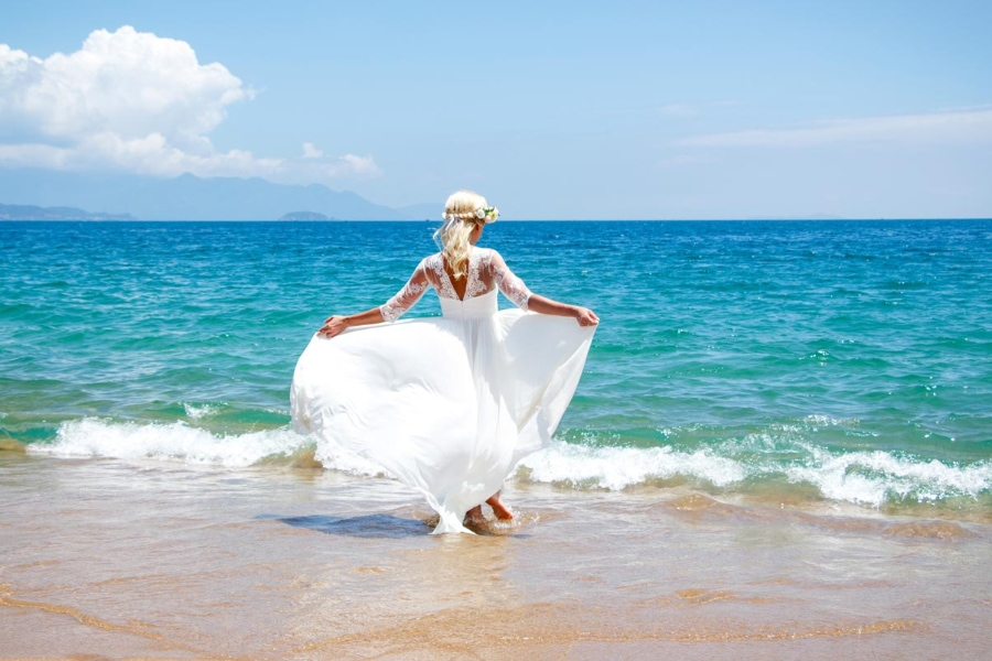 beach wedding photos bride in the sea 1