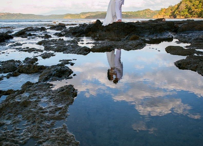 couple on Costa Rican Beach reflection 1