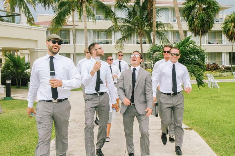 Destination wedding groomsmen wearing gray attire