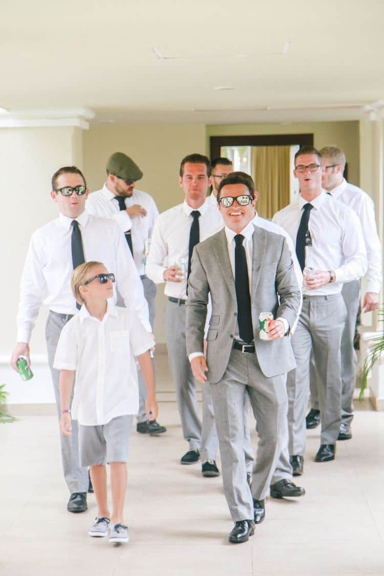 destination wedding groomsmen in gray attire