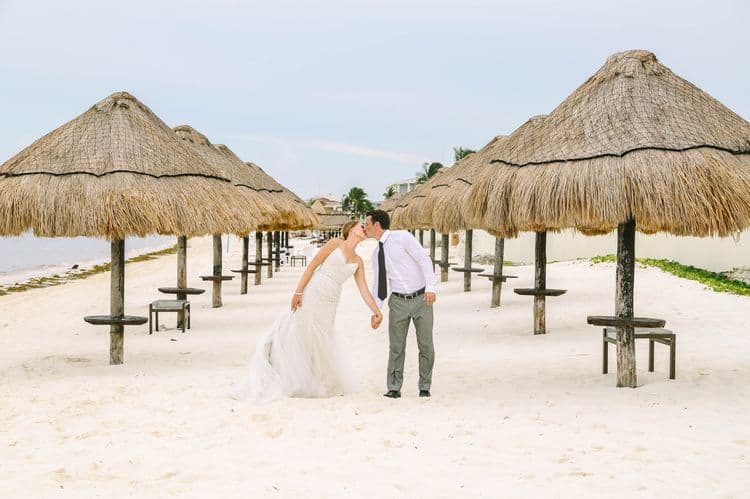 Cancun wedding photo with palapas on the beach