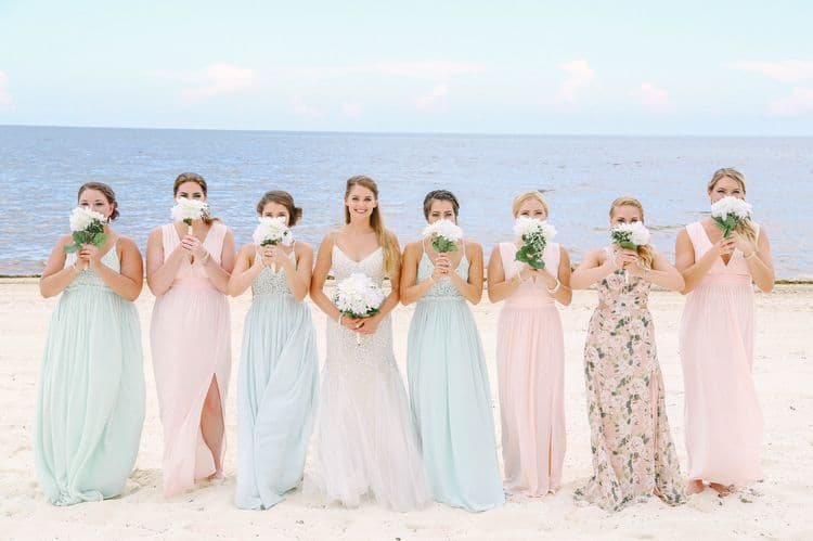 Beach wedding bridesmaids in pastel dresses