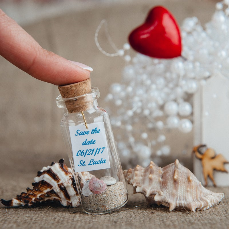destination wedding save the date message in a bottle