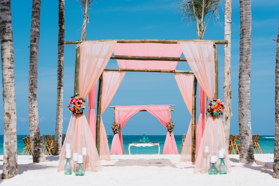 orange and fuchsia Beach wedding arch decorations