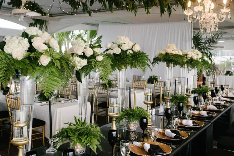 A gorgeous wedding in Barbados with black & gold table decorations
