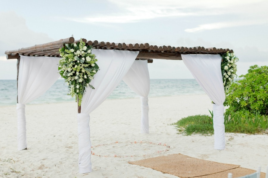 white beach wedding arch